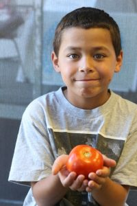 Young boy with Vegetables